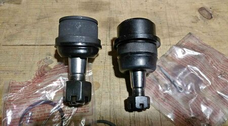 Two alternative black Ball joints of Moog and Proforged ball joints